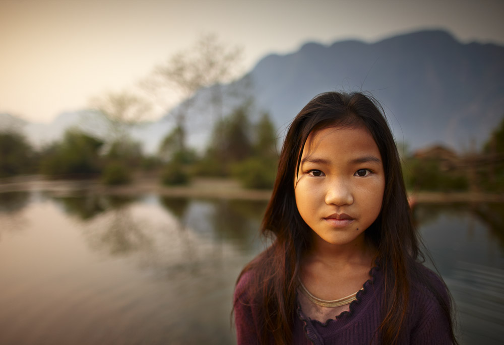 Portrait of a girl near Vang Vieng, Laos © David Noton